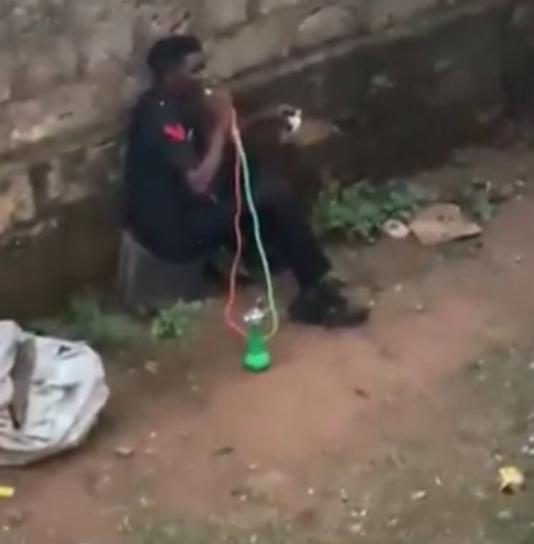 Nigerian Police Responds After Man In A Police Uniform Was Filmed Smoking Shisha In Public, Conquest Online Magazine